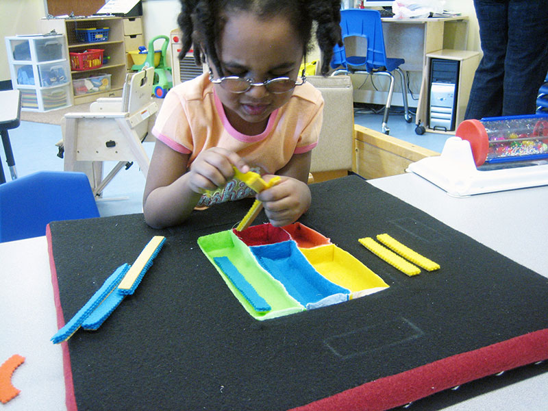 Child playing with thereputic toy during observational research